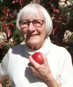 Betty Holding apple, close up